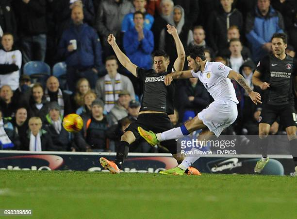 Leeds United's Alex Mowatt scores the opening goal as Charlton Athletic's Jonnie Jackson try's to block