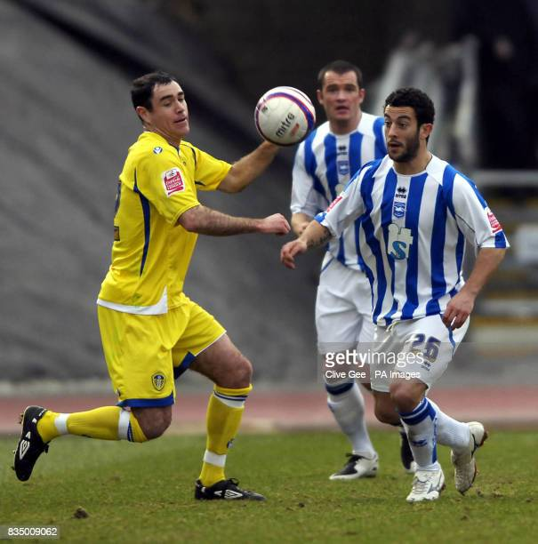Leeds United's Andy Hughes and Brighton and Hove Albion's Stuart Fleetwood battle for the ball during the CocaCola Football League One match at the...