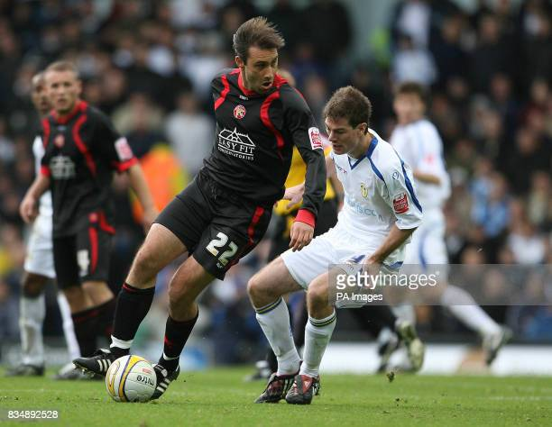 Leeds United's Ben Parker and Walsall's Marco Reich during the CocaCola League One match at Elland Road Leeds