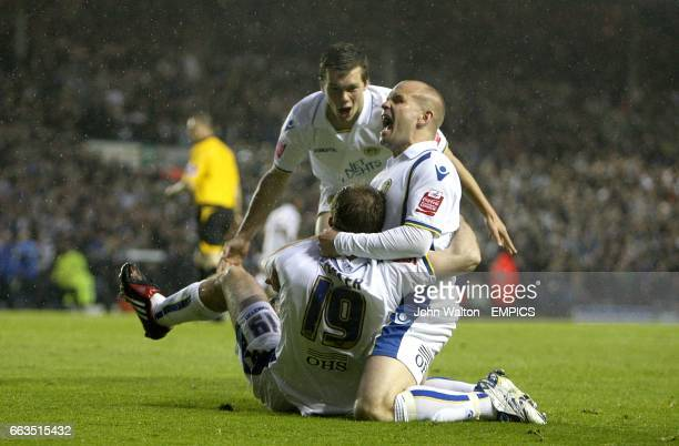 Leeds United's Ben Parker Andy Robinson and Jonathan Howson celebrtae after team mate Luciano Becchio scores the first goal