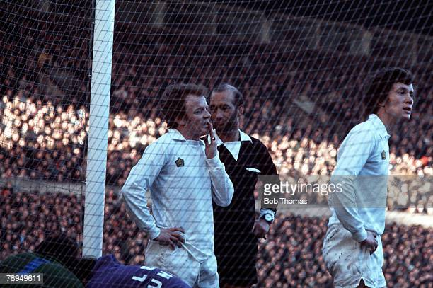 Leeds United's captain Billy Bremner is spoken to by the referee with teammate Trevor Cherry close by
