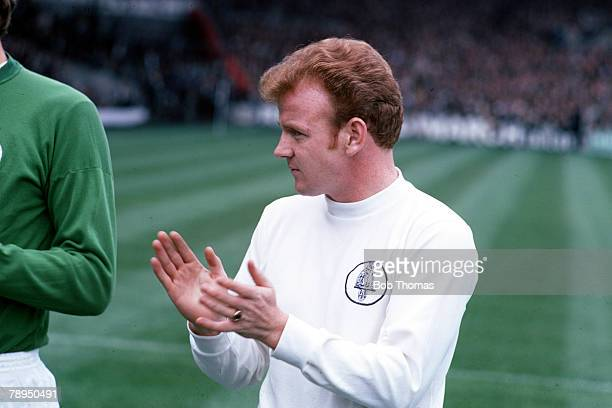 Leeds United's captain Billy Bremner joins in a round of applause