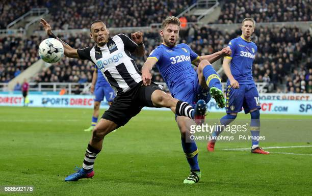 Leeds United's Charlie Taylor and Newcastle United's Yoan Gouffran battle for the ball during the Sky Bet Championship match at St James' Park...