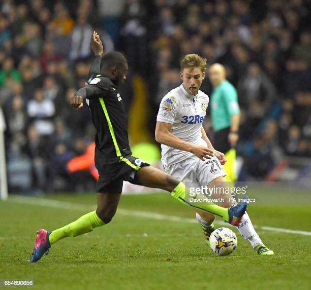 Leeds United's Charlie Taylor battles with Brighton and Hove Albion's Fikayo Tomori during the Sky Bet Championship match at Elland Road Leeds