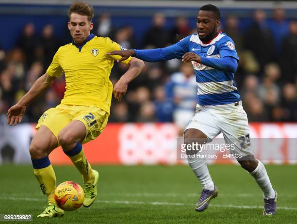Leeds United's Charlie Taylor clears the ball under pressure from Queens Park Rangers' David Hoilett