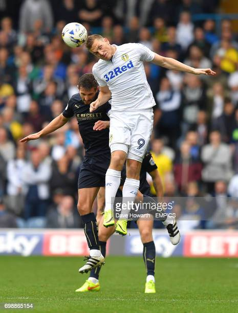 Leeds United's Chris Wood out jumps Barnsley's Conor Hourihane