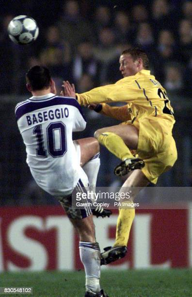 LEAGUE Leeds United's David Batty battles for the ball with Anderlecht's Walter Baseggio during a UEFA Champions League match at the Stade Constant...