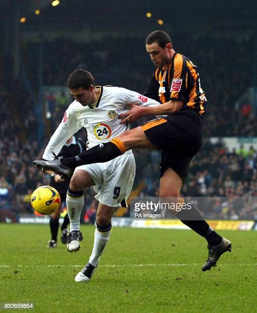Leeds United's David Healy battles with Hull's Damien Delaney during the CocaCola Championship match at Elland Road Leeds