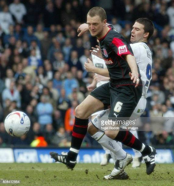 Leeds United's David Healy is held up by Stoke City's Clint Hill during the CocaCola Championship match at Elland Road Leeds Saturday March 25 2006...