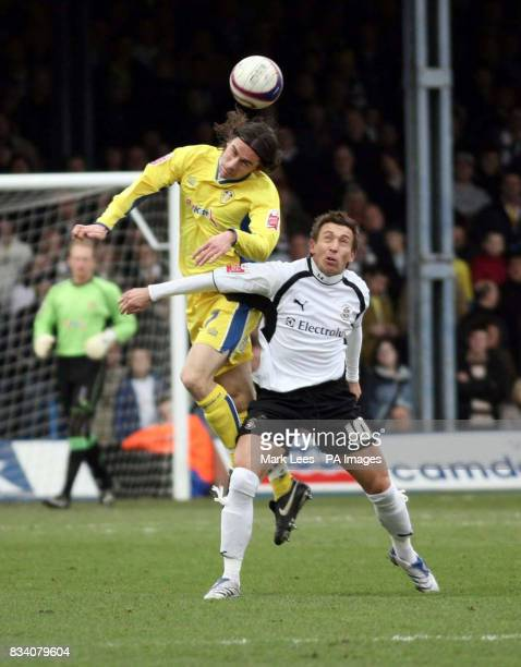 Leeds United's David Prutton in action with Luton's Darren Currie during the League One match at Kenilworth Stadium Luton
