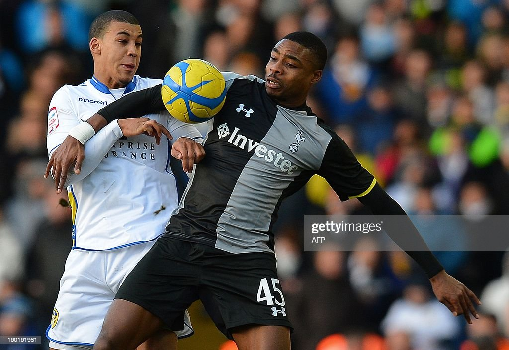 """Leeds United's English defender Lee Peltier (L) vies with Tottenham's John Obkia during the FA Cup football match between Leeds United and Tottenham Hotspur at Elland road stadium in Leeds, northern England on January 27, 2013. Leeds won 2-1. AFP PHOTO/ANDREW YATES. RESTRICTED TO EDITORIAL USE. No use with unauthorized audio, video, data, fixture lists, club/league logos or """"live"""" services. Online in-match use limited to 45 images, no video emulation. No use in betting, games or single club/league/player publications."""