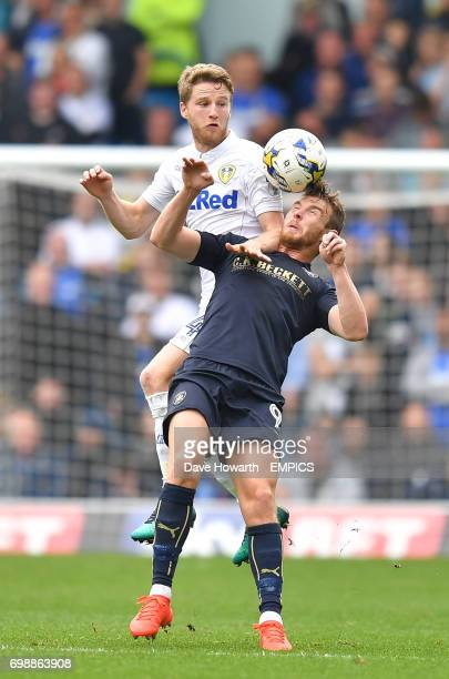 Leeds United's Eunan O'Kane out jumps Barnsley's Sam Winnall