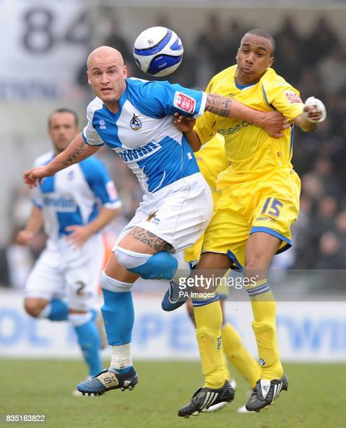 Leeds United's Fabian Delph and Bristol Rovers' David Pipe battle for the ball