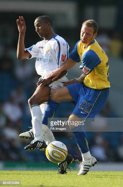 Leeds United's Fabian Delph and Hereford's Matt Done during the CocaCola Football League One match at Elland Road Leeds PRESS ASSOCIATION Photo...