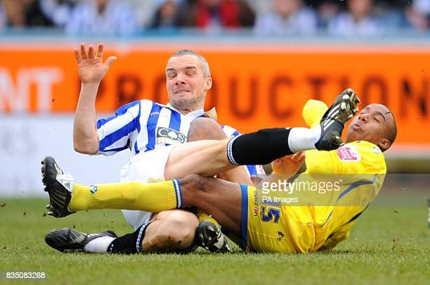 Leeds United's Fabian Delph and Huddersfield Town's Jim Goodwin collide after a battle for the ball