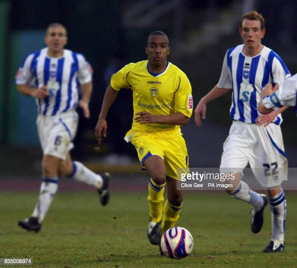Leeds United's Fabian Delph dribbles through the Brighton defence during the CocaCola Football League One match at the Withdean Stadium Brighton