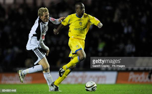 Leeds United's Fabian Delph gets past Derby's Paul Green during the Carling Cup Fourth Round match at Pride Park Derby