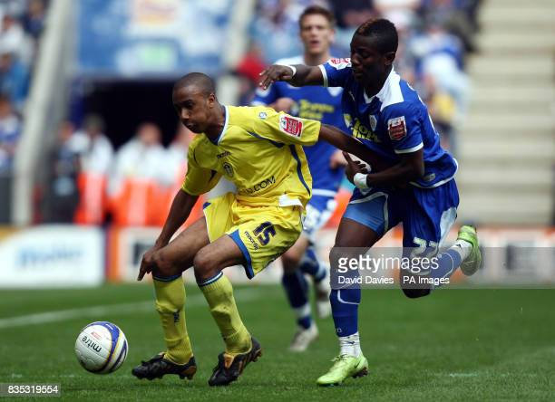 Leeds United's Fabian Delph is challenged by Leicester's Max Gradel during the CocaCola Football League One match at the Walkers Stadium Leicester