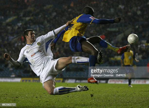 Leed's United's Frazer Richardson and Hereford United's Theo Robinson