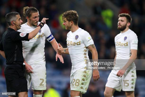 Leeds United's Gaetano Berardi speaks with referee Darren Bond as he is sent off the pitch with a cut on his eye during the Carabao Cup third round...