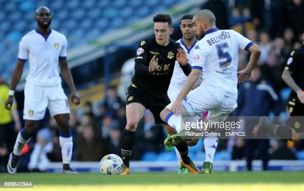 Leeds United's Giuseppe Bellusci tackles Bolton Wanderers' Zach Clough