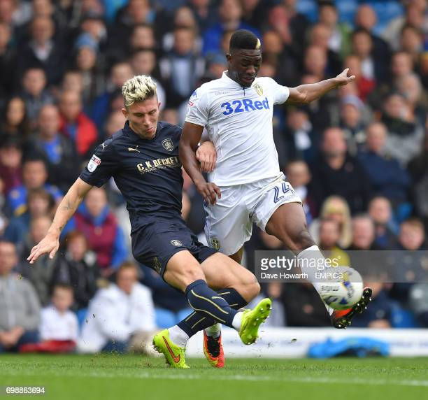 Leeds United's Hadi Sacko battles with Barnsley's Angus MacDonald