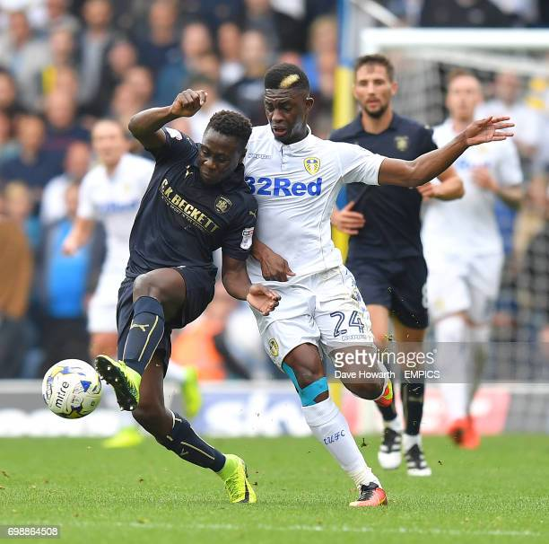 Leeds United's Hadi Sacko battles with Barnsley's Cole Kpekawa