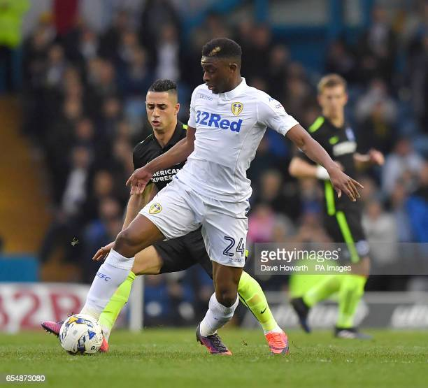 Leeds United's Hadi Sacko battles with Brighton and Hove Albion's Beram Kayal during the Sky Bet Championship match at Elland Road Leeds