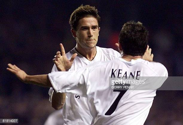 Leeds United's Harry Kewell celebrates with Irish teammate Robbie Keane after Kewell scored Leeds' second goal against CS Martimo during the UEFA Cup...