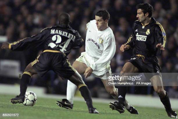 LEAGUE Leeds United's Ian Harte battles with Real Madrid's Makelele and Figo during their Champions League Group D match at Elland Road Leeds