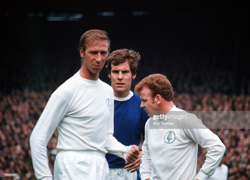 Leeds United v Everton, Leeds United's Jack Charlton and Billy Bremner are watched by Everton forward Joe Royle