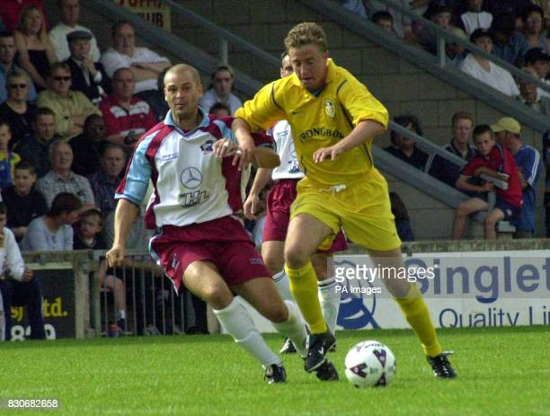 LEAGUE Leeds United's James McMaster in action against Scunthorpe's Carl Bradshaw during a preseason friendly at Glanford Park Scunthorpe