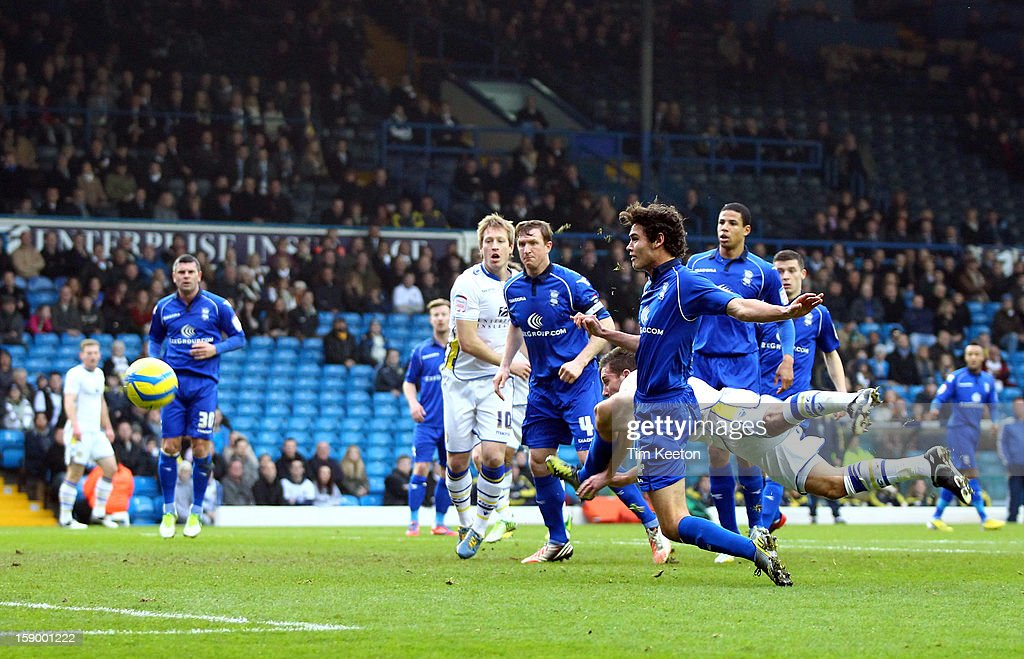 Leeds United's Jason Pearce heads a goal ward past Birmingham City's Will Packwood during the FA Cup with Budweiser Third Round match between Leeds United and Birmingham City at Elland Road Stadium on January 5, 2013 Leeds, England.