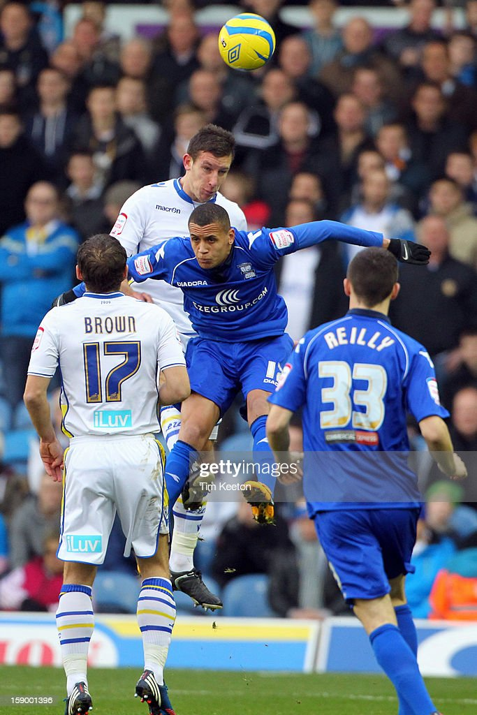 Leeds United's Jason Pearce out jumps Birmingham City's Ravel Morrison watched by Leeds United's Michael Brown and Birmingham City's Callum Reilly during the FA Cup with Budweiser Third Round match between Leeds United and Birmingham City at Elland Road Stadium on January 5, 2013 Leeds, England.