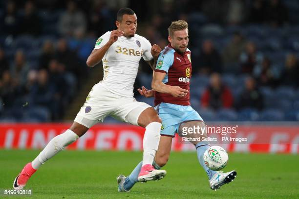 Leeds United's JayRoy Grot and Burnley's Charlie Taylor battle for the ball during the Carabao Cup third round match at Turf Moor Burnley