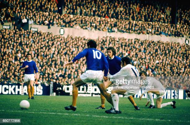Leeds United's Johnny Giles shoots for goal watched by teammate Allan Clarke and Everton's John Hurst and Roger Kenyon