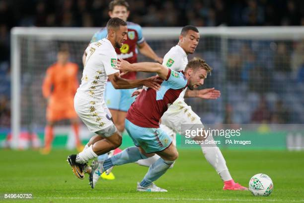 Leeds United's Kemar Roofe and Burnley's Charlie Taylor battle for the ball during the Carabao Cup third round match at Turf Moor Burnley