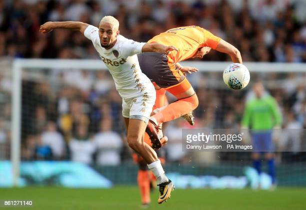 Leeds United's Kemar Roofe and Reading's Chris Gunter battle for the ball during the Sky Bet Championship match at Elland Road Leeds