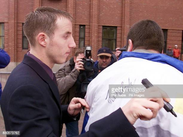 Leeds United's Lee Bowyer signs an autograph as he arrives at Hull Crown Court on the latest day of the Leeds United footballers' trial as the jury...