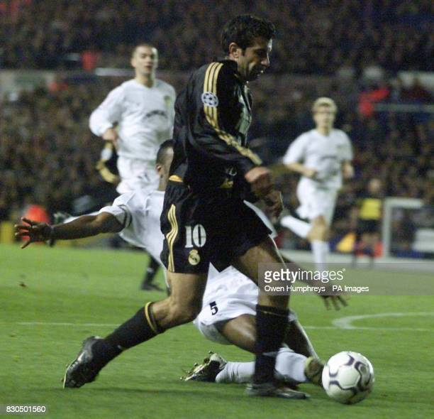 LEAGUE Leeds United's Lucas Radebe battles with Real Madrid's Figo during their Champions League Group D match at Elland Road Leeds