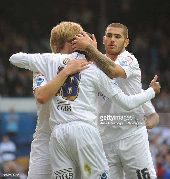 Leeds United's Lucciano Becchio celebrates his goal with Sanchez Watt and Bradley Johnson during the Carling Cup first round match at Elland Road...