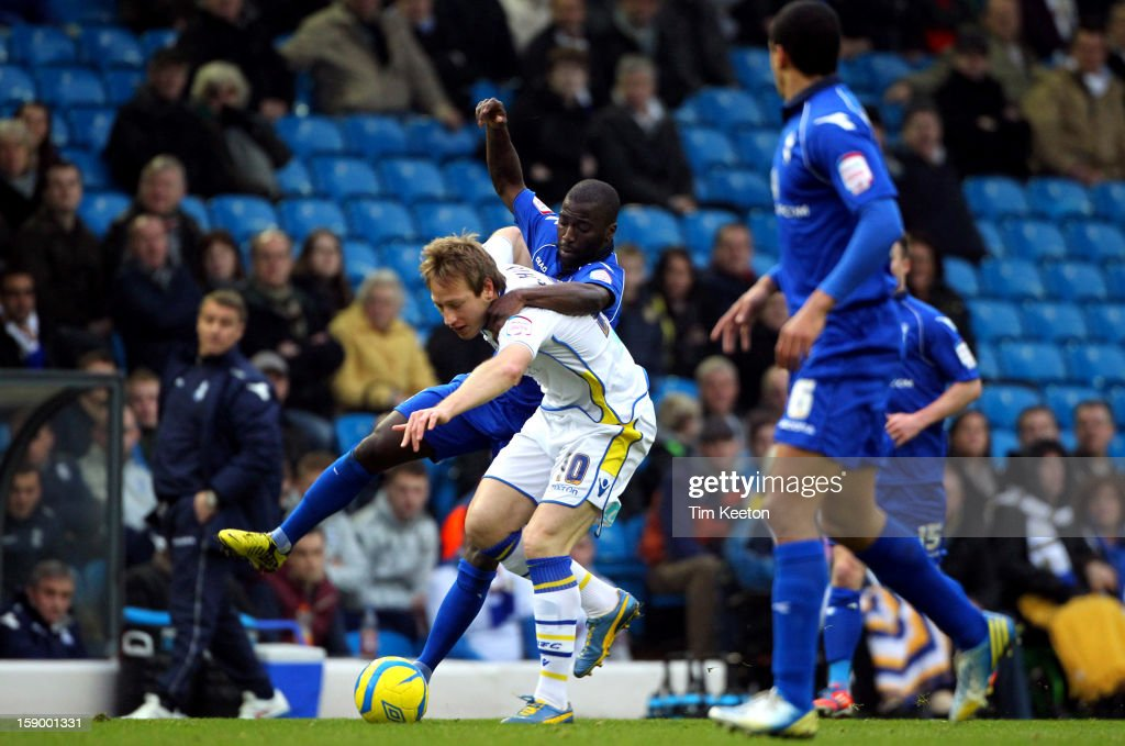 Leeds United's <a gi-track='captionPersonalityLinkClicked' href=/galleries/search?phrase=Luciano+Becchio&family=editorial&specificpeople=5489468 ng-click='$event.stopPropagation()'>Luciano Becchio</a> and Birmingham City's Morgaro Gomis tussle for the ball during the FA Cup with Budweiser Third Round match between Leeds United and Birmingham City at Elland Road Stadium on January 5, 2013 Leeds, England.