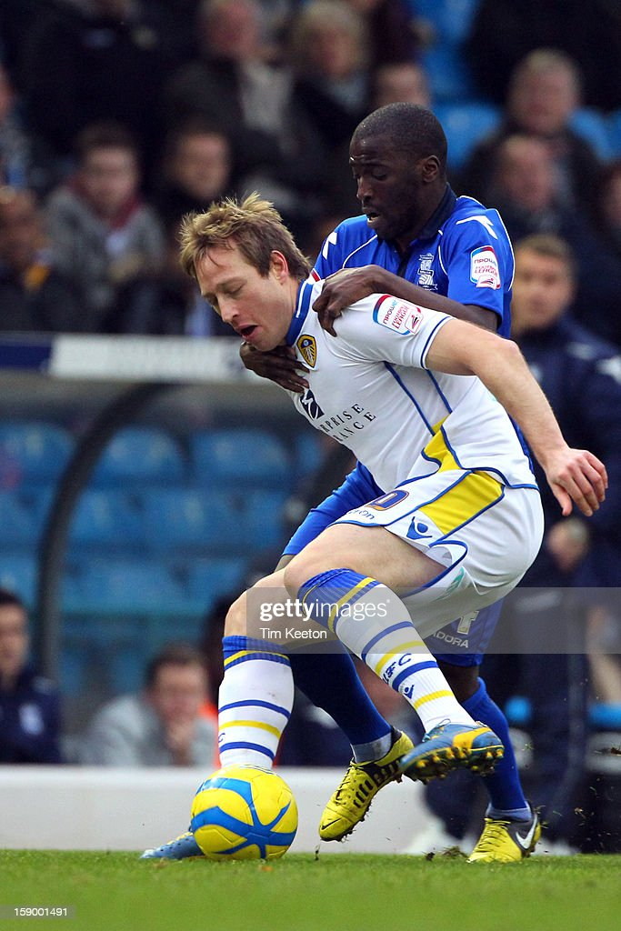 Leeds United's Luciano Becchio and Birmingham City's Morgaro Gomis tussle for the ball during the FA Cup with Budweiser Third Round match between Leeds United and Birmingham City at Elland Road Stadium on January 5, 2013 Leeds, England.