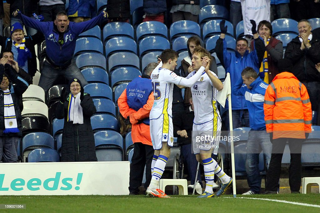 Leeds United's <a gi-track='captionPersonalityLinkClicked' href=/galleries/search?phrase=Luciano+Becchio&family=editorial&specificpeople=5489468 ng-click='$event.stopPropagation()'>Luciano Becchio</a> celebrates his equaliser with team-mate Paul Connolly during the FA Cup with Budweiser Third Round match between Leeds United and Birmingham City at Elland Road Stadium on January 5, 2013 Leeds, England.