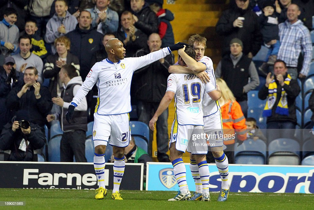 Leeds United's <a gi-track='captionPersonalityLinkClicked' href=/galleries/search?phrase=Luciano+Becchio&family=editorial&specificpeople=5489468 ng-click='$event.stopPropagation()'>Luciano Becchio</a> celebrates his equaliser with team-mates El-Hadji Diouf and <a gi-track='captionPersonalityLinkClicked' href=/galleries/search?phrase=David+Norris+-+Soccer+Player&family=editorial&specificpeople=5599377 ng-click='$event.stopPropagation()'>David Norris</a> during the FA Cup with Budweiser Third Round match between Leeds United and Birmingham City at Elland Road Stadium on January 5, 2013 Leeds, England.