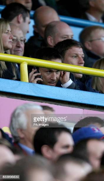 Leed's United's manager Dennis Wise keeps in touch with his staff from the stands during the CocaCola Football League One match at Brunton Park...