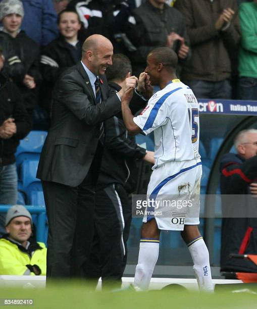 Leeds United's Manager Gary McAlister congratulates Leeds United's Fabian Delph during the CocaCola League One match at Elland Road Leeds