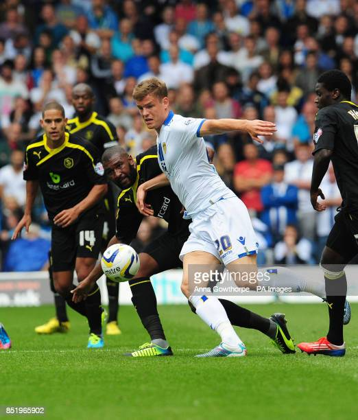 Leeds United's Matt Smith and Sheffield Wednesday's Reda Johnson during the Sky Bet Football League Championship match at Elland Road Leeds