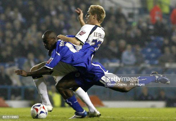 Leeds United's Matthew Kilgallon brings down Leicester City's Elvis Hammond which led to Kilgallon's sending off during the CocaCola match at Elland...