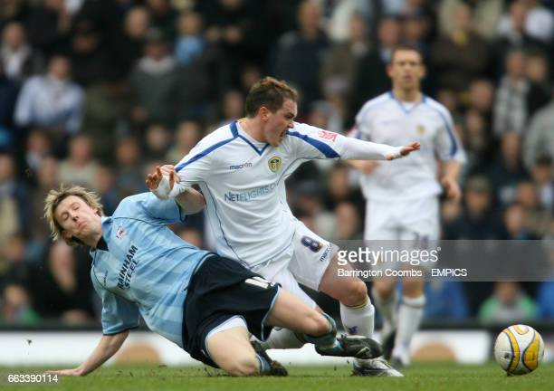 Leeds United's Neil kilkenny and Scunthorpe United's Martyn Woolford